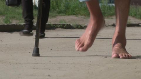 Bare feet are on the asphalt Stock Video Footage