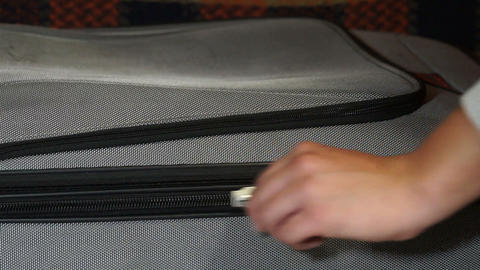 Zipper clasp on a suitcase Stock Video Footage