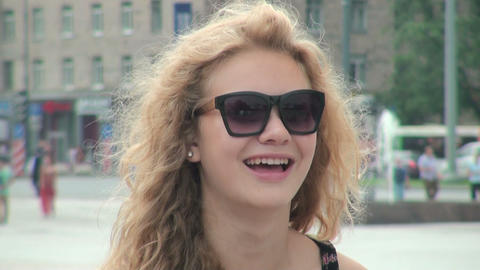The Blonde girl in sunglasses Stock Video Footage