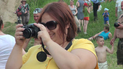 A stout woman with a camera Footage