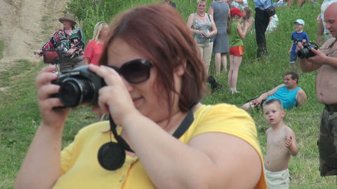 A stout woman with a camera Stock Video Footage