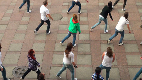 A group of girls dancing in the square Stock Video Footage