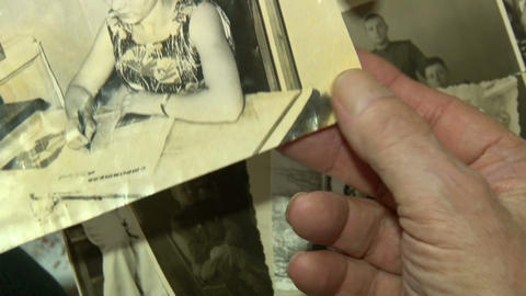 Old pictures in the hands of the elders Footage