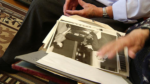 Old pictures in the hands of the elders Stock Video Footage