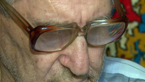 Eyes of an elderly man in glasses Stock Video Footage