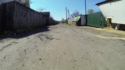 Travel on a dirt road in the village Stock Video Footage