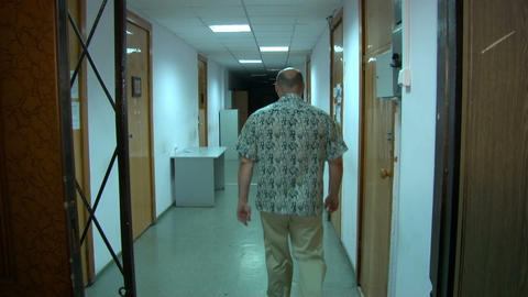 A man is walking along the corridor Stock Video Footage