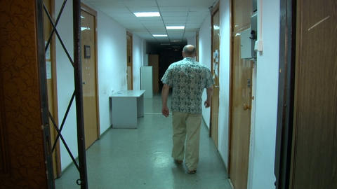 A man is walking along the corridor Footage