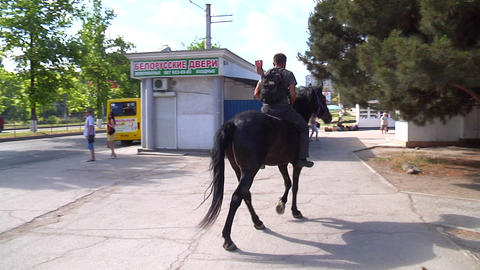 The man on the horses in the city Stock Video Footage