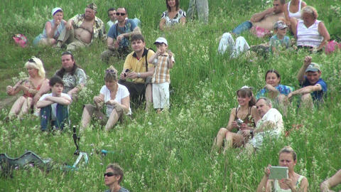 People have a rest on the grass Footage