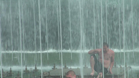 A man in a fountain Footage