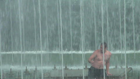 A man in a fountain Stock Video Footage
