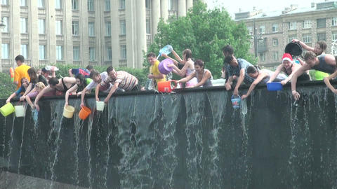 Young people trying to enter the water in a bowl a Footage
