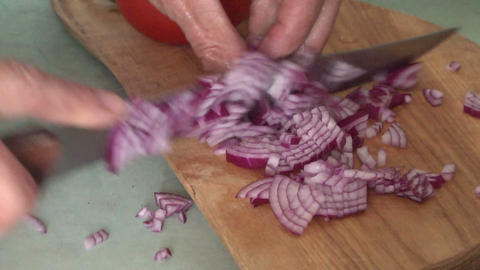 Cutting knife red onion Footage