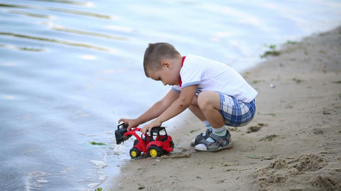 A little boy plays with the car Stock Video Footage