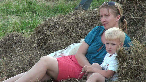 Mother with her son in a haystack Stock Video Footage