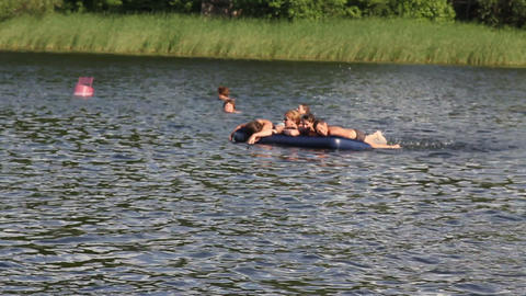 Children swim on an inflatable mattress Stock Video Footage