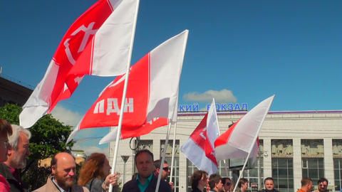 People with red-white flags at the rally Stock Video Footage