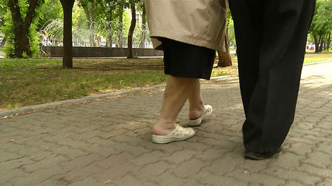 The legs of the two older men Stock Video Footage