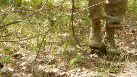 Mens feet on a forest road Stock Video Footage