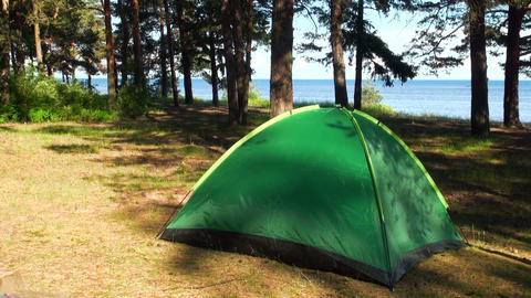 A green tent on the nature Stock Video Footage
