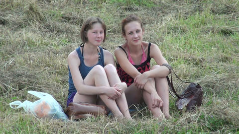 Two girls friend are sitting on the grass Stock Video Footage
