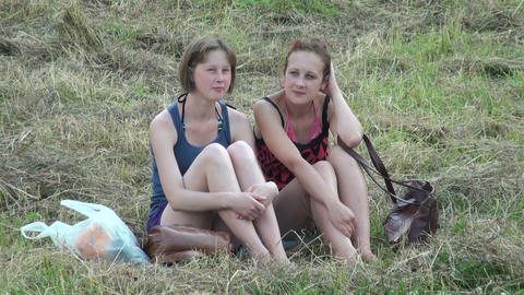 Two girls friend are sitting on the grass Footage
