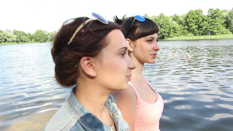 Girl friend are walking by the river Stock Video Footage