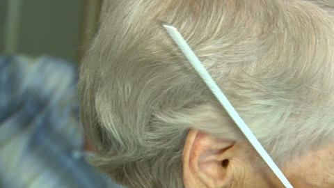 Combing Of Hair Graying stock footage