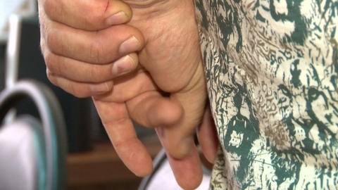 Men's hands folded behind Stock Video Footage