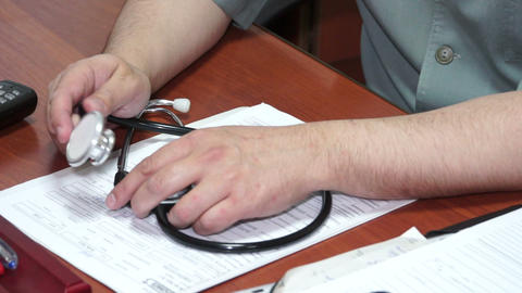 Stethoscope At The Hands Of The Doctor stock footage