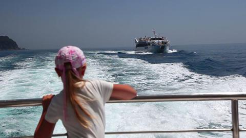 little girl on fast motor boat on sea, summer vaca Stock Video Footage