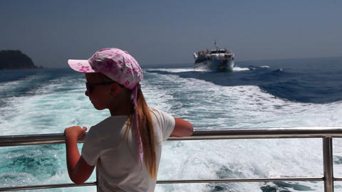 little girl on fast motor boat on sea, summer vaca Footage