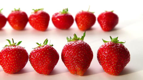 organic strawberries on white background - dolly s Stock Video Footage