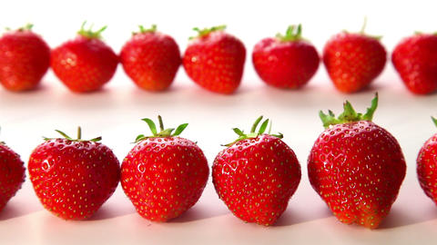 organic strawberries on white background - dolly s Footage