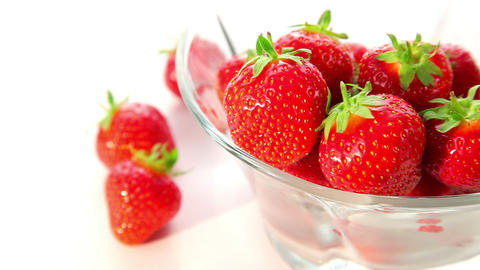 strawberries in a glass bowl - dolly shot Stock Video Footage