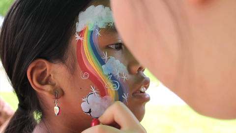 Girl Gets Rainbow Face Painting Stock Video Footage