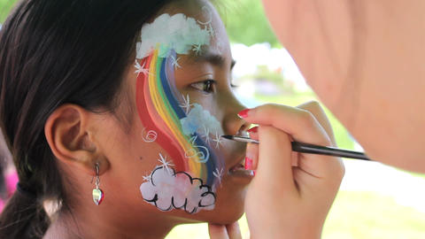Girl Gets Rainbow Face Painting Footage