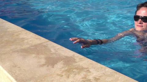 Girl at the side of the pool HD Stock Video Footage