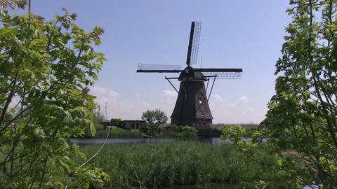 Windmill and boat Stock Video Footage