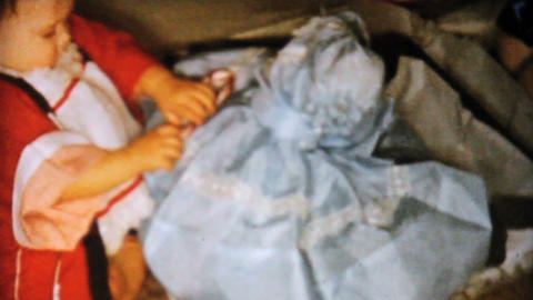 Baby Girl Gets Blue Dress For Christmas 1962 Stock Video Footage