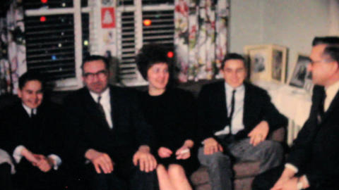 Family Enjoying Time Together At Christmas 1962 Stock Video Footage