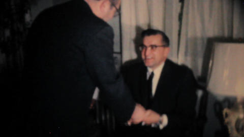 Two Men Joking Around With Christmas Gifts 1962 Stock Video Footage