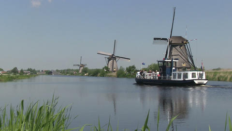 Dutch Windmills And Tourist Boat stock footage