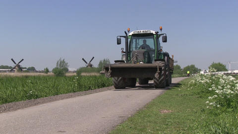 Tractor And Windmills In The Netherlands stock footage