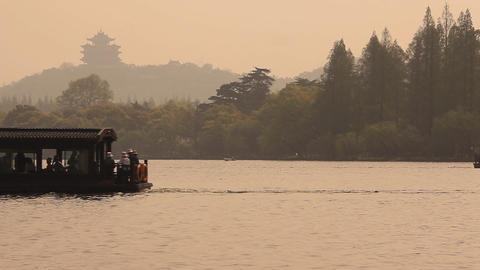 Boats go on the lake with Chinese pagoda Stock Video Footage