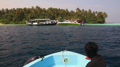 Motor boat slowly slides on a turquoise surface of Stock Video Footage