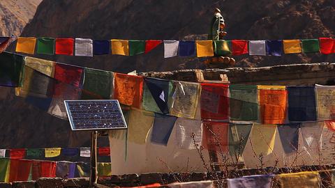Solar panel among Tibetan prayer flags Stock Video Footage