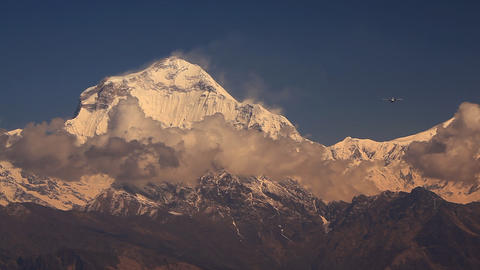 Plane flies against Dhaulagiri peak Stock Video Footage