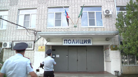 Two policemen come to the police Department Stock Video Footage